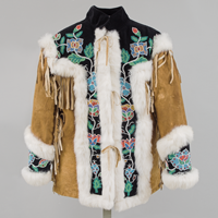 Man's jacket of smoked caribou hide with collar and yoke of beaded black velvet and trimmed with white fox fur and decorative floral beading.