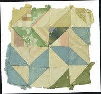 A small patchwork of interlocking triangles of different patterns and light pastel colours, made by Fanny Riley.