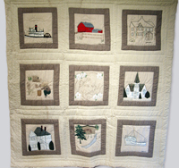 A large quilt with nine embroidered squares highlighting the role of farming and fishing to the economic development in the town of Ladner, British Columbia.