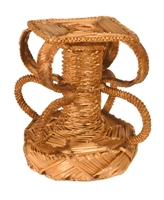 Rough, intricate vase handmade from golden coloured wheat straw.