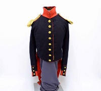 Dark navy uniform with golden buttons and epaulets, trimmed at collar and cuff with scarlet red, originally worn by William Duff in the 1830s.