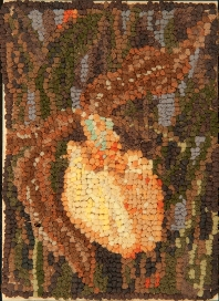 A rug hooking depicting of a rare yellow lady's slipper flower, an excellent example of artist Delza Longman's signature hooking style.