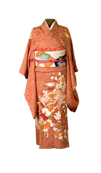A silk hand sewn orange kimono with flowered detail, owned by Kimi Wakabayashi.