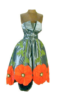 A dress featuring large poppies in red-orange silk, with olive green stems and leaves on grey taffeta.
