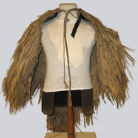 A traditional Chinese rain cape with many layers of reeds bundled from the shoulders, preventing rain from penetrating into the lower layers.