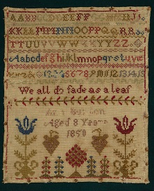 A sampler colourfully embroidered with flowers, the alphabet, numbers 1-15, the words 'we all do fade as a leaf' and the name and age of its maker.