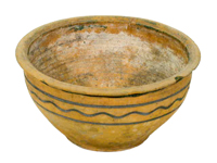 A sparsely decorated, naturally coloured clay bowl, smooth and skillfully shaped by Peter Rupchan.