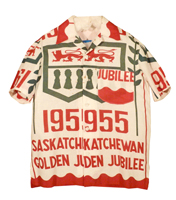 A cotton shirt made from a banner for Saskatchewan Golden Jubilee celebrations, featuring bold red lettering.