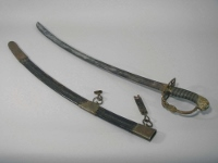 Curved sword and sheath with hilt made of brass with sharkskin and blade of steel with embossed decorations, owned by James Muirhead.