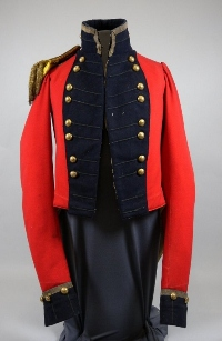 Military coat made with red brushed-wool broadcloth with black lace on dark-blue wool lapels, collar, and cuffs, worn by Captain John McMicking.