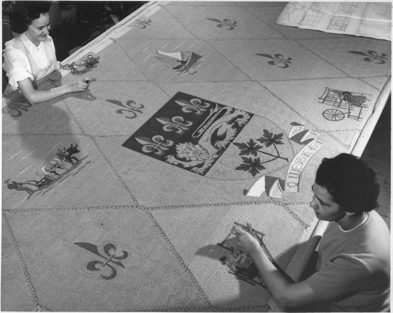 Two women working on a tapestry designed by Tremblay for the Royal York Hotel in Toronto, 1960.