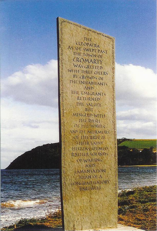 The Emigration Stone in Cromarty, Scotland, a tall modest stone monument to the number of Scots who left for Canada on the ship Cleopatra.