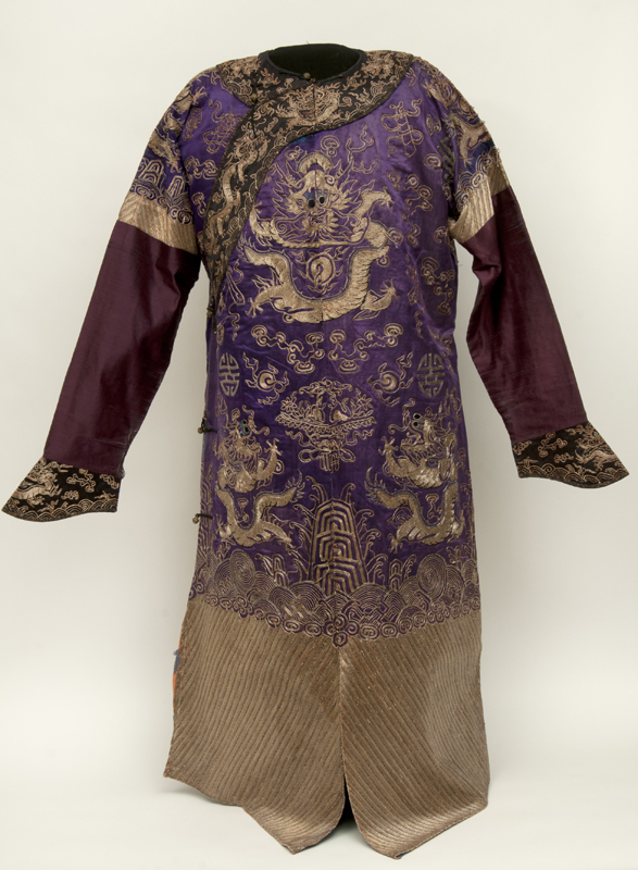 Opulent purple silk robe with intricate designs in couched gold thread worn during the Qing dynasty (1644–1911) by members of the Imperial family.