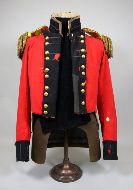 The scarlet military coat of Aeneas Shaw with golden buttons and epaulets and trimmed with dark navy blue.