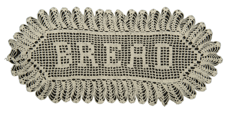 A breadbasket liner with the word 'Bread' at center, made by Kathleen M. McKechnie before 1957.
