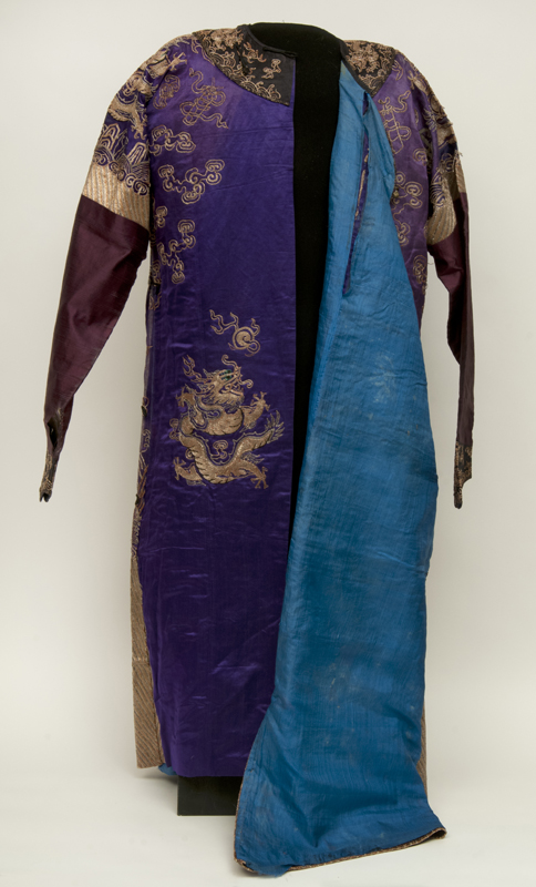 The robe opened at the front, revealing a vivid blue silk interior and an additional gold dragon hidden inside.