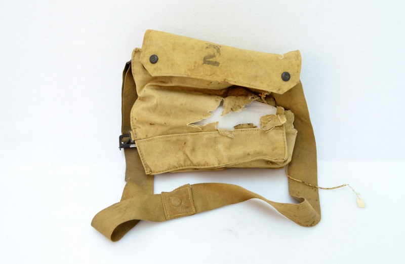 British First World War canvas gas mask carrying bag, torn with age but in otherwise good condition.