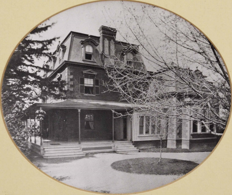 Historic photograph of an elegant 3 storey home with wrap around veranda, owned by the Plumb family.