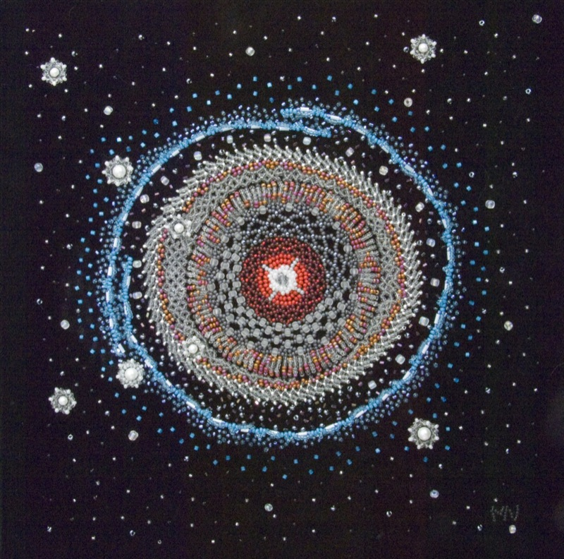 A colourful textile representation of an image from the Hubble Space Telescope created using a combination of sewing, embroidery, and beadwork.