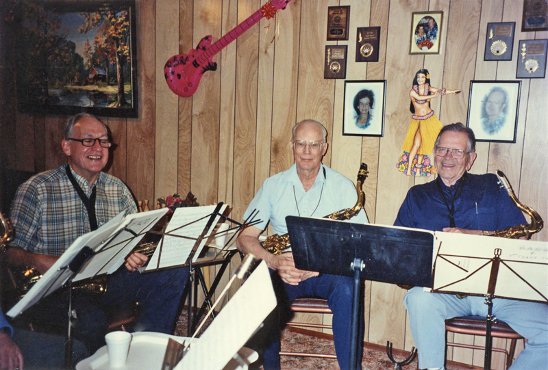 Four members of the 'The Most Amazing Hobby Band' practicing in a home.