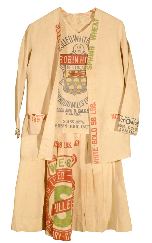 Dress and jacket made from flour sacks, prominently covered in various flour company labels.