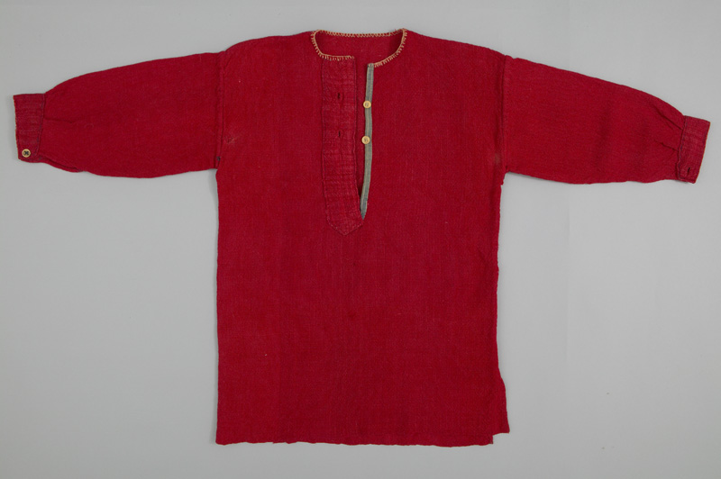 A bright red shirt with three quarter length sleeves, white stitching around the collar and two buttons.