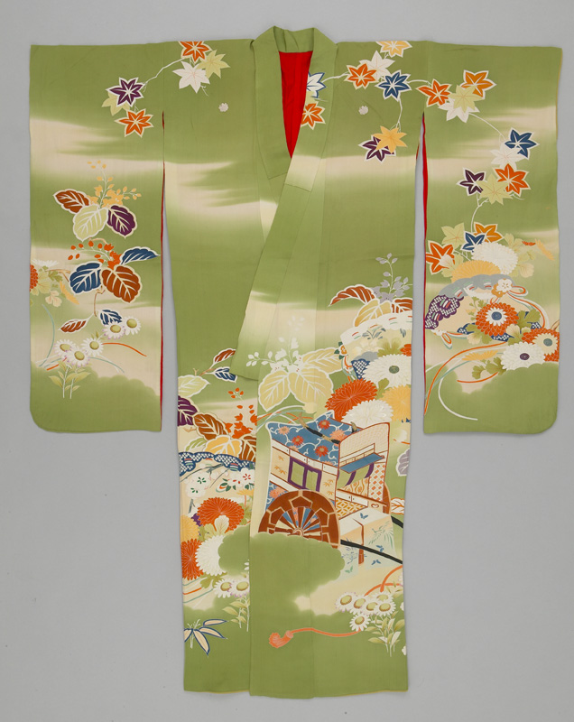 A light green kimono with a red lining covered in floral imagery and an image of a carriage, laid flat.