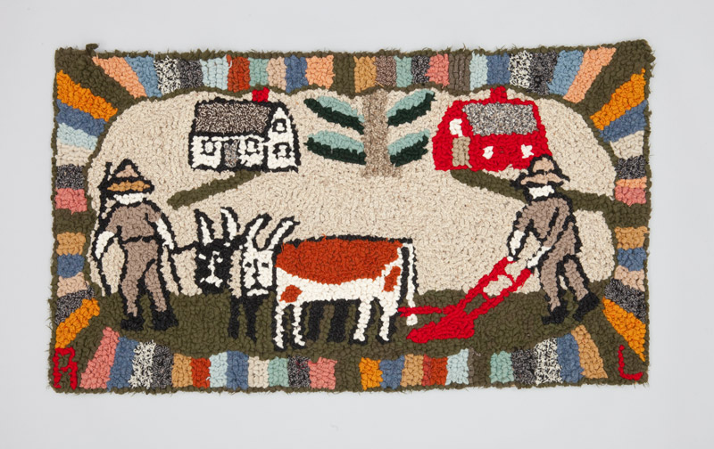 A burlap and wool hooked rug depicting life on a rural farm, goats stand while a farmer pushes a bright red till in the foreground.