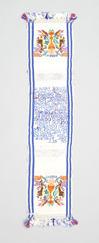 Rear view of a skillfully stitched white rectangular woven textile panel with blue borders and red highlights.